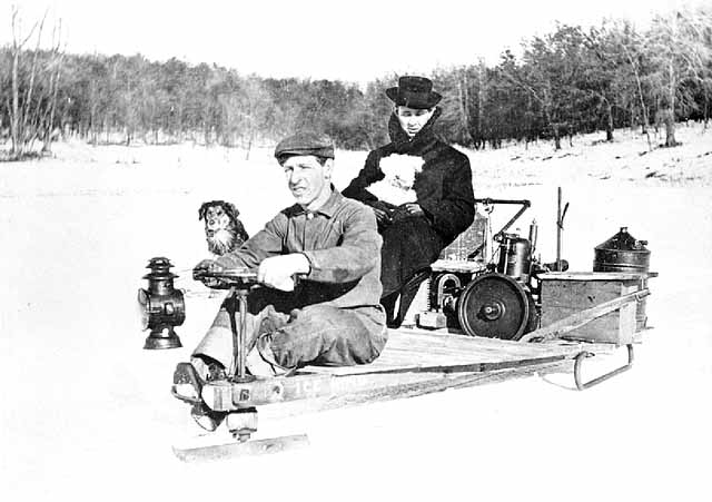 Black and white image of homemade snowmobile.