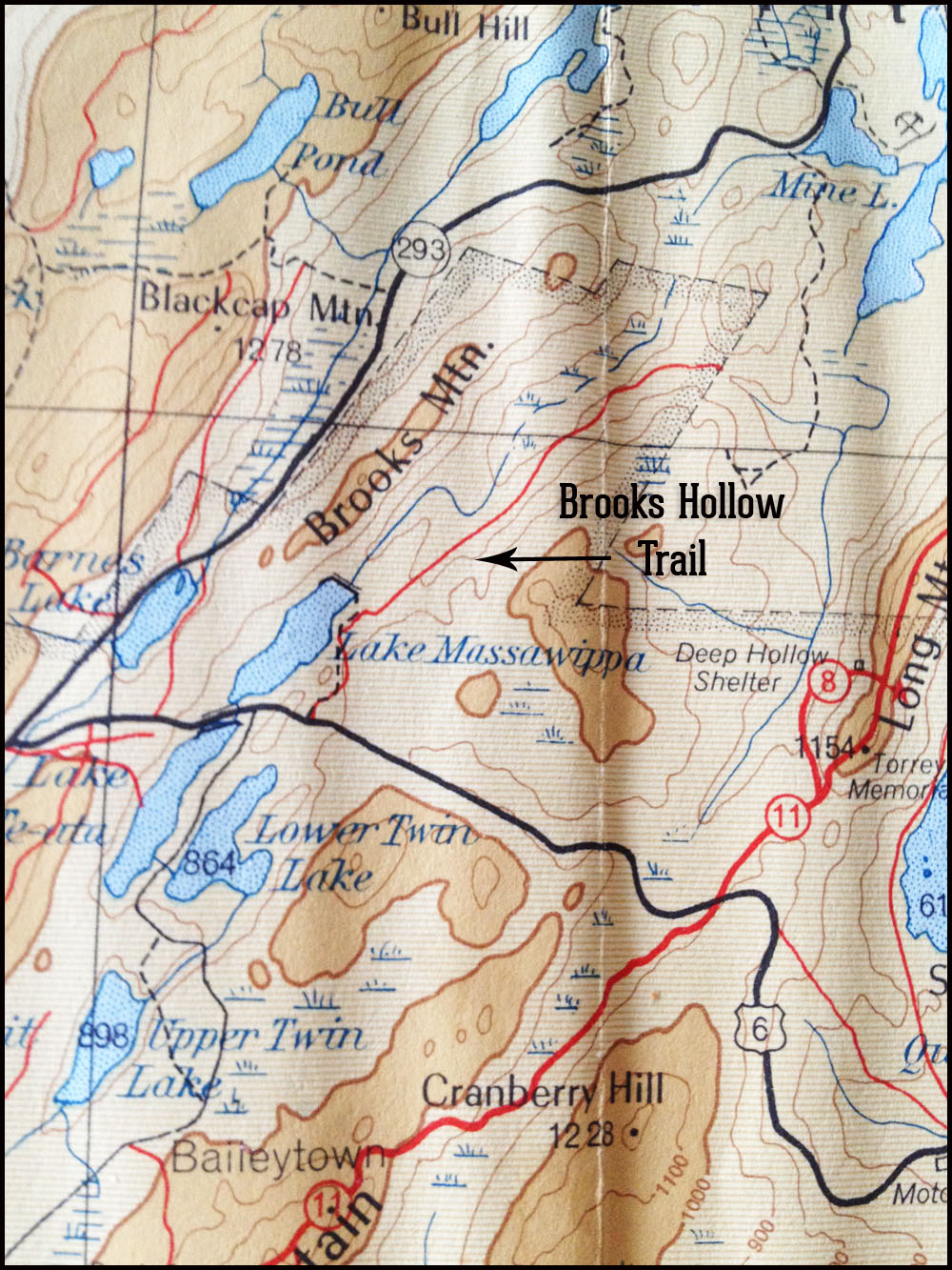 A hiker's map of Harriman State Park New York from 1953, showing old trails and woods roads that are no longer in existence.  This map is creased.