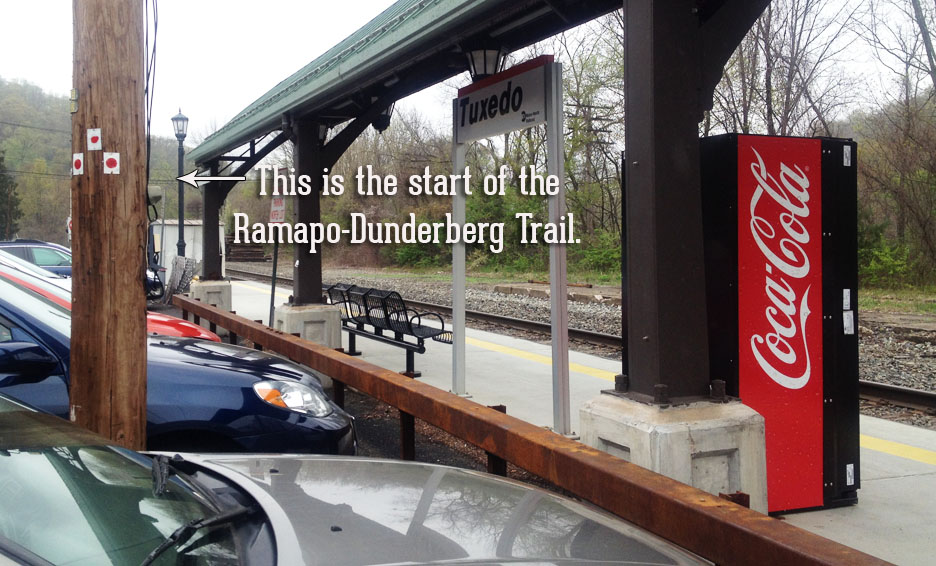 The start of the Ramapo-Dunderberg trail in Harriman State Park, begins in the parking lot of Tuxedo train station.